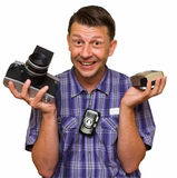Man chooses the camera Stock Images