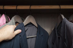 Man chooses clothes Royalty Free Stock Image