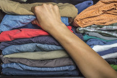 Man chooses clothes in the wardrobe Royalty Free Stock Images