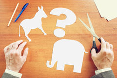 Man chooses between Democrats and Republicans. Conceptual image Stock Photos