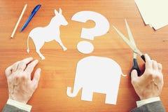 Man chooses between Democrats and Republicans. Conceptual image. With paper scrapbooking Stock Photos
