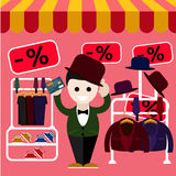 Man chooses perfect clothes and a hat in the store Royalty Free Stock Images