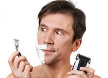 Man chooses razors Royalty Free Stock Photography