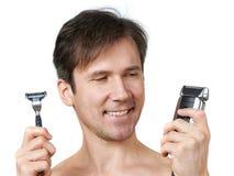 Man chooses razors Stock Photo