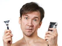 Man chooses razors Stock Images