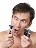 Man chooses razors Royalty Free Stock Photo