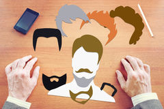 Man chooses style of haircut and beard. Concept with paper scrapbooking stock photography