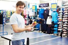 Man chooses table tennis racquet in shop Stock Photos