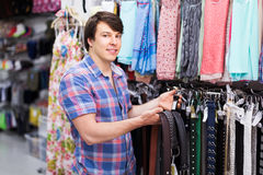 Man choosing belts in shop Stock Photography