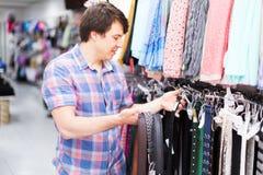 Man choosing belts in shop Stock Photos