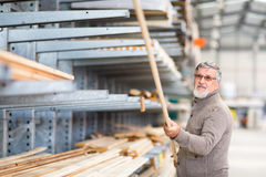 Man choosing and buying construction wood Royalty Free Stock Images