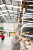 Man choosing and buying construction wood Royalty Free Stock Photography