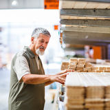 Man choosing and buying construction wood in a  DIY store Stock Image