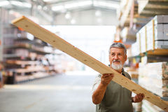 Man choosing and buying construction wood in a  DIY store Royalty Free Stock Photo