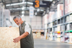 Man choosing and buying construction wood in a  DIY store Stock Photos
