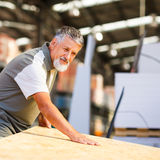 Man choosing and buying construction wood in a  DIY store Stock Photography