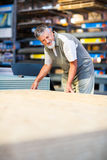 Man choosing and buying construction wood in a  DIY store Royalty Free Stock Images