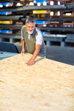 Man choosing and buying construction wood in a  DIY store Royalty Free Stock Photos