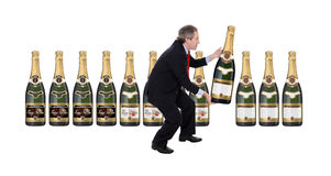 Man choosing a champagne bottle Stock Photography