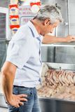 Man Choosing Chicken Meat At Butchery Royalty Free Stock Photo