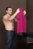 Man choosing clothes. Royalty Free Stock Photo