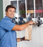 Man Choosing Coffee From Vending Machine Stock Image