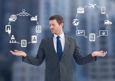 Man choosing or deciding business icons wheels with open palm hands. Digital composite of Man choosing or deciding business icons wheels with open palm hands Royalty Free Stock Image