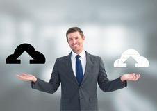 Man choosing or deciding cloud uploads icons with open palm hands. Digital composite of Man choosing or deciding cloud uploads icons with open palm hands stock photo