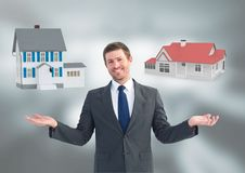 Man choosing or deciding houses with open palm hands. Digital composite of Man choosing or deciding houses with open palm hands stock photos