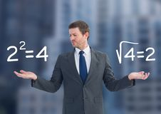 Man choosing or deciding math sums equations with open palm hands. Digital composite of Man choosing or deciding math sums equations with open palm hands Royalty Free Stock Photo