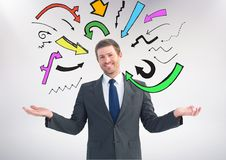 Man choosing or deciding with open palm hands and many colourful arrows around him. Digital composite of Man choosing or deciding with open palm hands and many Stock Photo