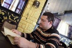 Man choosing dish Royalty Free Stock Photography
