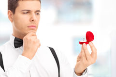 Man choosing an engagement ring in a jewelry store stock images