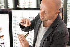 Man choosing glasses Royalty Free Stock Photo