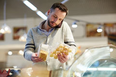 Man Choosing Groceries in Store Stock Photography