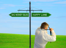 Man choosing happiness over wealth Royalty Free Stock Images