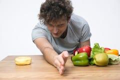 Man choosing healthy vegetables food Royalty Free Stock Image