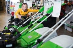 Man choosing lawnmower Stock Photography