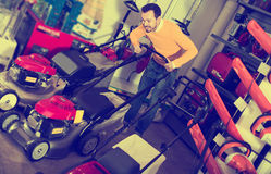 Man choosing lawnmower Royalty Free Stock Photo