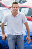 Man choosing new car. On lot Royalty Free Stock Images