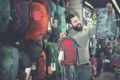 Man choosing on new rucksack royalty free stock photography
