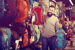 Man choosing on new rucksack stock photos