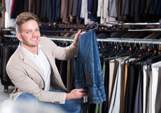 Man choosing new trousers Stock Photography