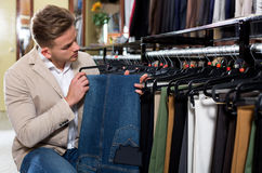 Man choosing on new trousers Royalty Free Stock Photos