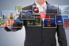 Man choosing one of images. Man choosing one of 3d streaming images Royalty Free Stock Image