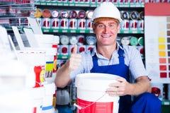 Man choosing paint bucket Royalty Free Stock Photos