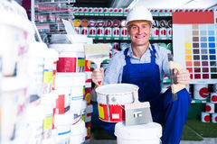 Man choosing paint bucket Stock Images