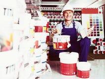 Man choosing paint bucket Royalty Free Stock Photo