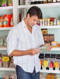 Man Choosing Product In Store Stock Image