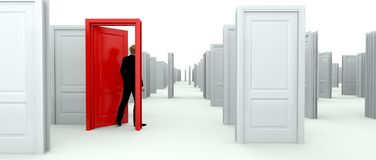 Man choosing a red door. Making a decision by choosing the red door to open from as room full of white identical doors Stock Images